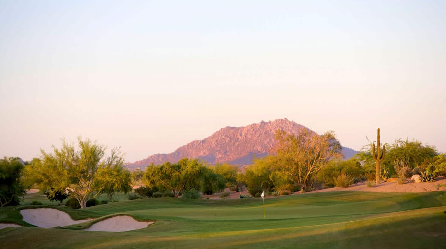 golf course in front of mountains
