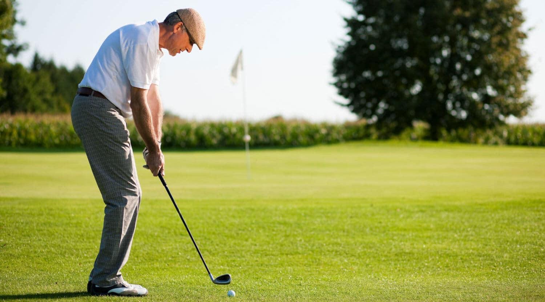 a senior man playing golf